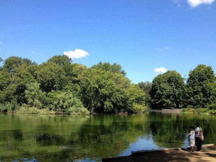The artificial lake at prospect park being enjoyed by two people